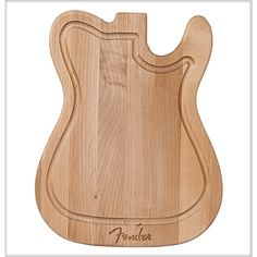No kitchen is complete without the eco-friendly Telecaster Cutting Board. Get your Fender chops together in the kitchen with this smartly designed cutting board, shaped like the body of the venerable Telecaster® guitar and made with recycled wood from Fender's Mexico manufacturing facility. #cuttingboard #fender #giftsforhim #kissthecook #recycledwood #greenliving #foodies #giftideas #cooking