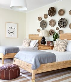 This guest bedroom uses basket art to create a focus wall | Sarah Bartholomew