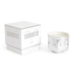 Jonathan Adler Matte Platinum Muse D'Argent Candle: A developed silver glaze that doesn't obscure the details of the muse face, is this chic and classique Muse Candle that will add a little luster to your life and comes in a chic box that's great for gifting. Spritely notes of pink grapefruit, French cassis and violet leaves. And after the candle is gone? The vessel is the perfect pot for a posse of pretty posies. Approx. burn time is 51 hrs. Always trim the wick before lighting the candle…