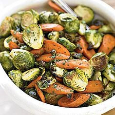 This Roasted Brussels Sprouts with Crispy Capers and Carrots recipe is bursting with flavor.  It's not only #vegetarian it's low-calorie, low-saturated fat, low-carbs AND low-cholesterol.  #autumn #fallfoods | Health.com