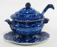 """CRN Auctions 9/21/14 Lot 102 : STAFFORDSHIRE HISTORICAL DEEP BLUE SAUCE TUREEN: CHADWICK [sic] ON THE THAMES oval covered tureen, 6.5""""h; 8""""w; with underplate, 8""""w; both with shell border; and a ladle with eagle-head handle and ship in bowl. Ensemble is pictured in Arman pg. 67 fig. b.  Tureen is Arman's Unidentified View (A153a & A153b). Undertray is Chiswick on the Thames (A128). Eagle handle ladle is Ship, Anchored (A150). Estimate: $300 - $500. Sold for $960 with premium."""