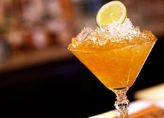 The Mardi Gras Kiss: 1½ oz. Brugal Añejo Rum; 1/2 oz. Amaretto; 1 oz. simple syrup; 1 oz. pineapple juice. In a shaker with ice, combine ingredients, shake well and strain into a martini glass. Garnish with a Maraschino cherry.