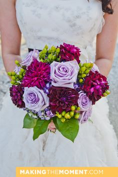 purple and green wedding bouquet: dahlias, roses, and green hypericum