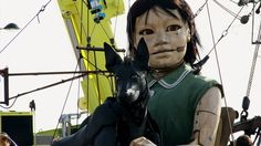 Puppet of giant girl tours Liverpool in 'Sea Odyssey'