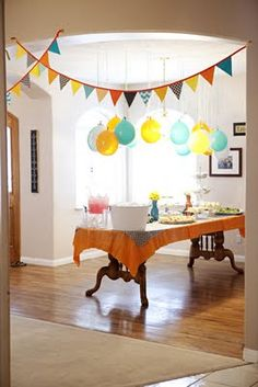 love the balloons hanging from the ceiling and the bunting #baby #bunting #party