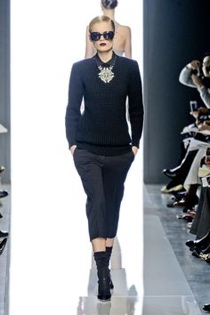 A textured cashmere sweater stood out as a fall basic worth the money, especially since Maier styled it first with a peplum pencil skirt, three strands of gray pearls and a woven tote. And a few exits later, over cropped pants with a brooch necklace and sunglasses. - HarpersBAZAAR.com