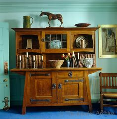 An Arts and Crafts dresser houses leather bound books and pieces of pottery Antique Writing Desk, Desk Cover, Arts And Crafts Interiors, Leather Bound Books, Eclectic Living Room, Japanese Paper, China Cabinet, Dresser, New Homes