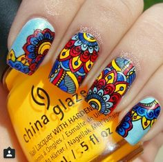 Instagram pic by alygaterrr. Red, yellow, blue advanced nail stamp technique.