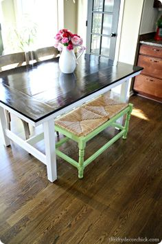 I stained it two times with the same dark stain (Rustoleum Kona) I used here. Then I gave it two coats of a gloss poly: