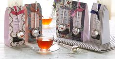 """I like this arrangement because I drink my tea """"black"""" and this tea is a lovely colour; I like the ribbons and the shape of the spoons; and I like the various patterns on the packets. From Whittard of Chelsea website, advert for their exclusive tea pouches Mar 2014"""