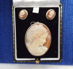 Mid Century Italian Carved Cameo Set, Brooch - Pendant, Earrings. sSet in 800 silver frames.