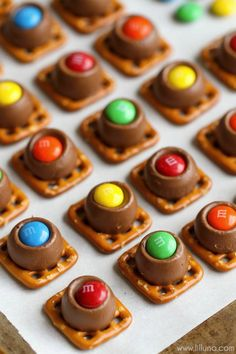 Candy Rolo Bites - butter pretzels topped with Rolos and M&Ms. This treat is always a hit recipe at every party!