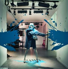 awash with bursts of colors, fountains of paint, and bodies in motion - Lanvin window installation
