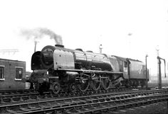 46227 'Duchess of Devonshire' at a grey and misty Crewe North shed. Built by the LMS at Crewe Works and delivered in streamlined red in June 1938 the casing was removed in February 1947. She was, with 46231 and 46232 in December 1962, the first of the class to be withdrawn and was scrapped at Crewe in November 1963. Photo by Keith Long