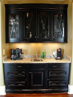 built in bar, love the glass cabinet doors. Also love the thought of the coffee being out of the kitchen.