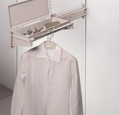 The Ambos Side Mounted Jacket Rack provides a hanging rod for your coat hangers and pulls out for easy access. It's fitted with a drawer top that is ideal for wallet, keys, coins etc. Mounted on left or right side and ideal for narrow spaces. Totally extractable.