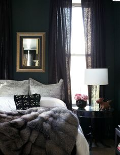 So cozy bedroom! Love the dark walls, filtering light through curtains, fur throw on bed