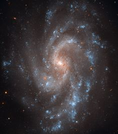 This view from the NASA/ESA Hubble Space Telescope shows the beautiful spiral galaxy NGC 5584. This galaxy has played a key role in a new study that measures the expansion rate of the Universe to greater accuracy than ever before. - Credit: NASA, ESA, and the Hubble Heritage Team (STScI/AURA)