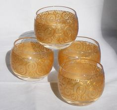 set of 4 hand painted glass candle holders, gold Pebeo paint with iridescent medium.