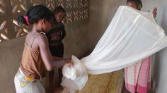 Proper malaria net usage demonstrations in Liberia