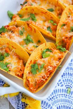 These Baked Chicken Tacos are the perfect dinner recipe. Stuffed with beans, chicken, and cheese then baked until crunchy. When you are ready to serve let everyone top them with their favorite taco style toppings. Baked Chicken Tacos, Easy Baked Chicken, Easy Chicken Recipes, Baked Tacos, Chicken Taquitos, Chicken Quesadillas, Mexican Dishes, Mexican Food Recipes, Dinner Recipes