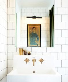 White subway tiles in bathroom with gold hardware