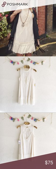 Free People Angel Lace Dress Pieced together lace and crochet dropwaist dress with raw edge pleated bottom hem. Featuring a high collar neckline and open back detailing. Two-button closure at the back of neck. Lined. 100% cotton. Free People Dresses Mini