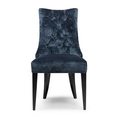 The Tufton dining chair is a brand new design to our collection. Traditional method of deep buttoning used on a slender curved back brings this design right up to date. The hand studded detail around the back of this chair highlights the shape beautifully.