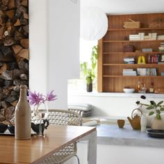 White walls, concrete countertop and timber mix.