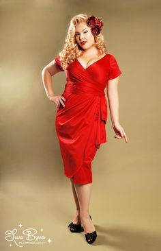 Ava Dress in Red by Pinup Couture - Plus Size - The Ava Dress has now become one of our most popular Pinup Couture styles for everything from a night on the town to bridal parties.  Offered in an array of jewel tones and wedding colors, the Ava is made of a luxurious shakira satin and features a faux wrap front and tulip skirt, back zipper, attached wrap belt, and gorgeous plunging neckline. The result is a cut flattering on just about every body type and suitable for a variety of occasions.