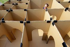 A child makes his way through a maze of cardboard boxes at a park in Tokyo.