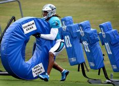 Carolina Panthers linebacker Shaq Thompson grabs ahold of a Roll Tackle Ring…