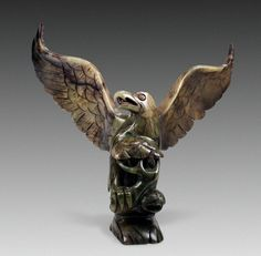 Jade Stone StatueChina, Yuan Dynasty - 1300's AD Variegated green jade stone statue of an eagle with gracefully spread wings...
