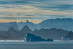 Icebergs and Mountains, photo by Janet Little Jeffers #Icebergs #Arctic #Photography #LandscapePhotography #JanetLittleJeffers