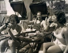 Palm Springs, California - April 12, 1933 - Allan Dinehart is pictured lounging back in his sun bathing chair while Luana Walters combs her hair and Moselle Brittone is quaffing the new legal beer at the El Mirador swimming pool. Need the chair