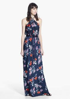 Sleeveless flowy long dress with floral print. Halter neck, cord to tie at waist, keyhole detail at back and inner lining.