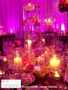 Very seductive and romantic floating candle centerpiece with hot pink background. #modern @janaeshields