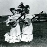 Girls with banjos; Veazie, Maine circa Maine Folklife Center Collection B y Alyce Ornella, North Country series Editor .