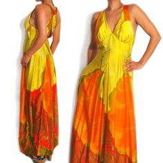 1960s Vintage Hawaiian Floral Bright Maxi Dress. Now Online. http://apartoftherest.com. A curated selection of designer and unique vintage