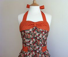Love 50s style aprons!  Retro apron with bow, vintage orange and peach floral pattern. Found on Etsy, Copyright © , RosieAnn 2011.