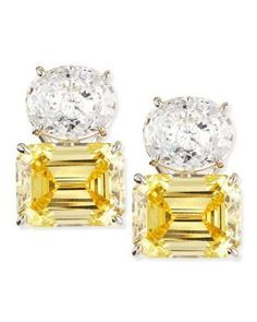"""18-karat gold plating over sterling silver with rhodium finish earrings from Fantasia by DeSerio. Oval-cut white cubic zirconia. Emerald-cut canary cubic zirconia. 26.0 total carat weight. Omega post backs for pierced ears. Approx. 3/4""""L (20mm) overall. Made in USA."""