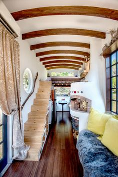 A DIY tiny house its owners built themselves for approximately $15,000! Features exposed beams, laundry facilities, and a wood-burning oven!