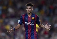 Barcelona's Brazilian forward Neymar da Silva Santos Junior celebrates his goal during the 49th Joan Gamper Trophy football match FC Barcelona vs Leon Club at the Camp Nou stadium in Barcelona on August 18, 2014.