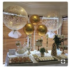 Simply elegance with tulle covered jumbo balloons and golden orbz