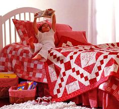 Quilts for Kids - looks like she used embroidered blocks in the quilt.  Very cute!