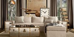 Love the large clock and the mixture of linen and silver, with bronze accents. Love the floor lamp!