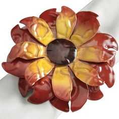 I love napkin rings that could double as fashion accessories! - Embossed Metal Sunflower Napkin Ring
