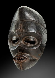 exhibitor of Ibibio illness mask Brown wood with shiny patina Nigeria H 29 cm