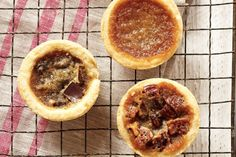 Delectable custardy Maple Butter tarts. We've subbed in the very Canadian ingredient maple syrup for the more common corn syrup. Plus, we've included variations on the classic, with chocolate and pecans instead of raisins.