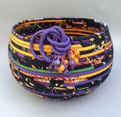 Celebration is a basket that just bursts with color. Bright yellow, deep purple, emerald green and p Rope Basket, Basket Weaving, Rope Rug, Fabric Bowls, Vases, Clothes Basket, Rope Crafts, Yarn Bowl, Clothes Line